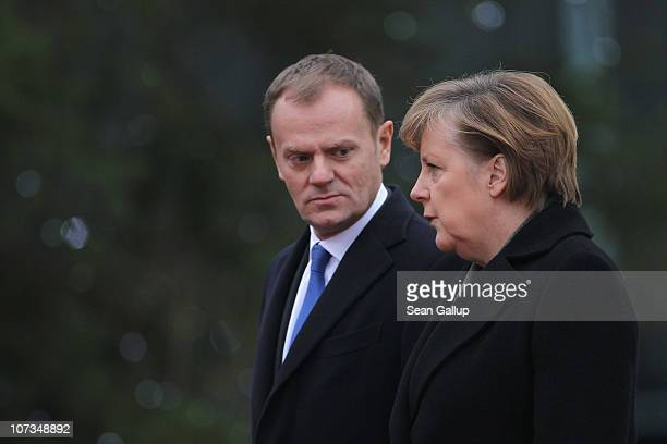 German Chancellor Angela Merkel and Poland's Prime Minister Donald Tusk chat upon Tusk's arrival at the Chancellery on December 6 2010 in Berlin...