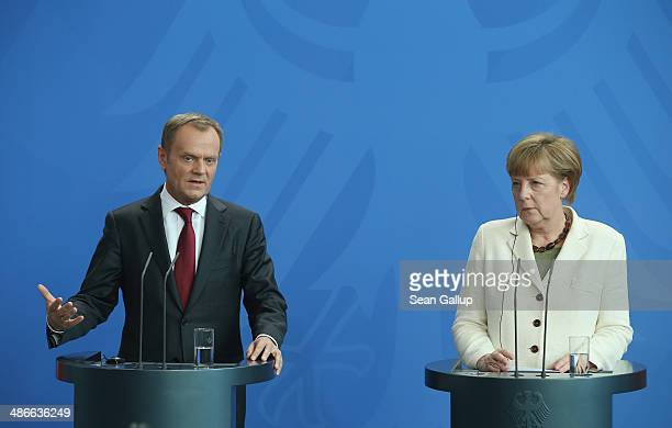 German Chancellor Angela Merkel and Polish President Donald Tusk give statements to the media upon Tusk's arrival at the Chancellery on April 25 2014...