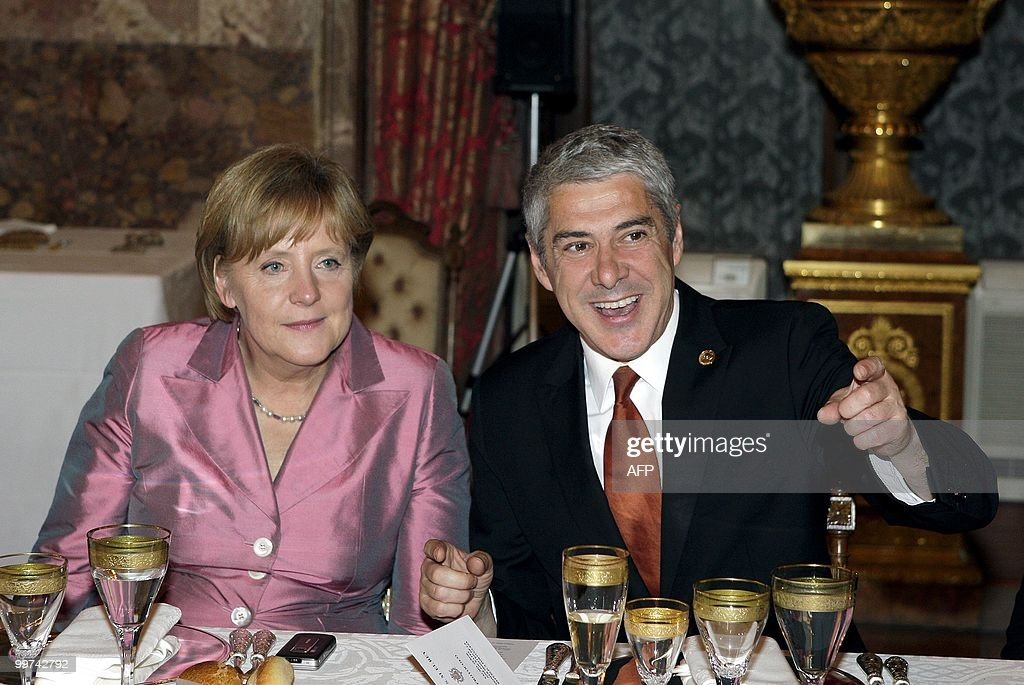 German Chancellor Angela Merkel (L) and Portugal's Prime Minster Jose Socrates attend a gala dinner at The Royal Palace in Madrid on May 17, 2010. European and Latin America heads of states meet in Madrid from 17 to 19 May, 2010 during an European Union-Latin America and Caribean countries summit organized by the Spanish rotating presidency of the EU.