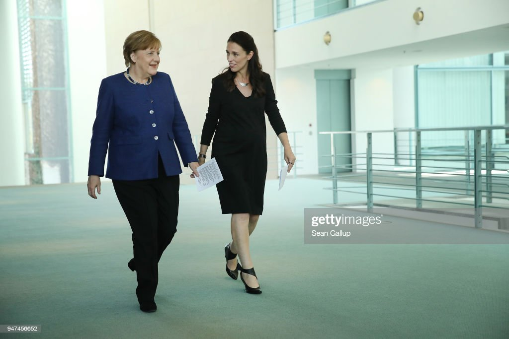 German Chancellor Angela Merkel (L) and pregnant New Zealand Prime Minister Jacinda Ardern arrive to speak to the media following talks at the Chancellery on April 17, 2018 in Berlin, Germany. The two leaders discussed common security, trade, educational exchange and other issues.