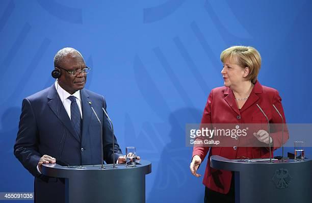 German Chancellor Angela Merkel and President Ibrahim Boubacar Keita of Mali speak to the media following talks at the Chancellery on December 11...