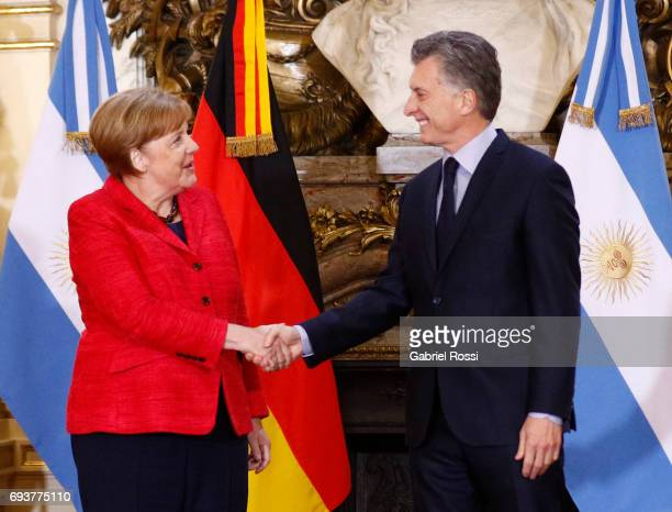German Chancellor Angela Merkel and President of Argentina Mauricio Macri shake hands prior a press conference as part of an official visit of German...