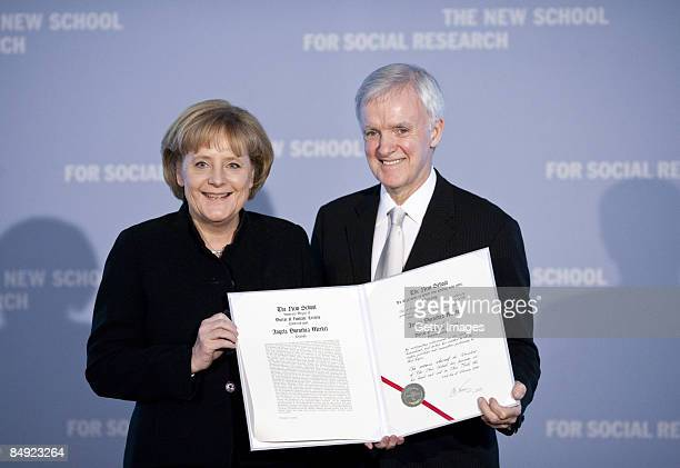 German Chancellor Angela Merkel and President of the New School For Social Research Bob Kerrey present the certificate during the presentation of...