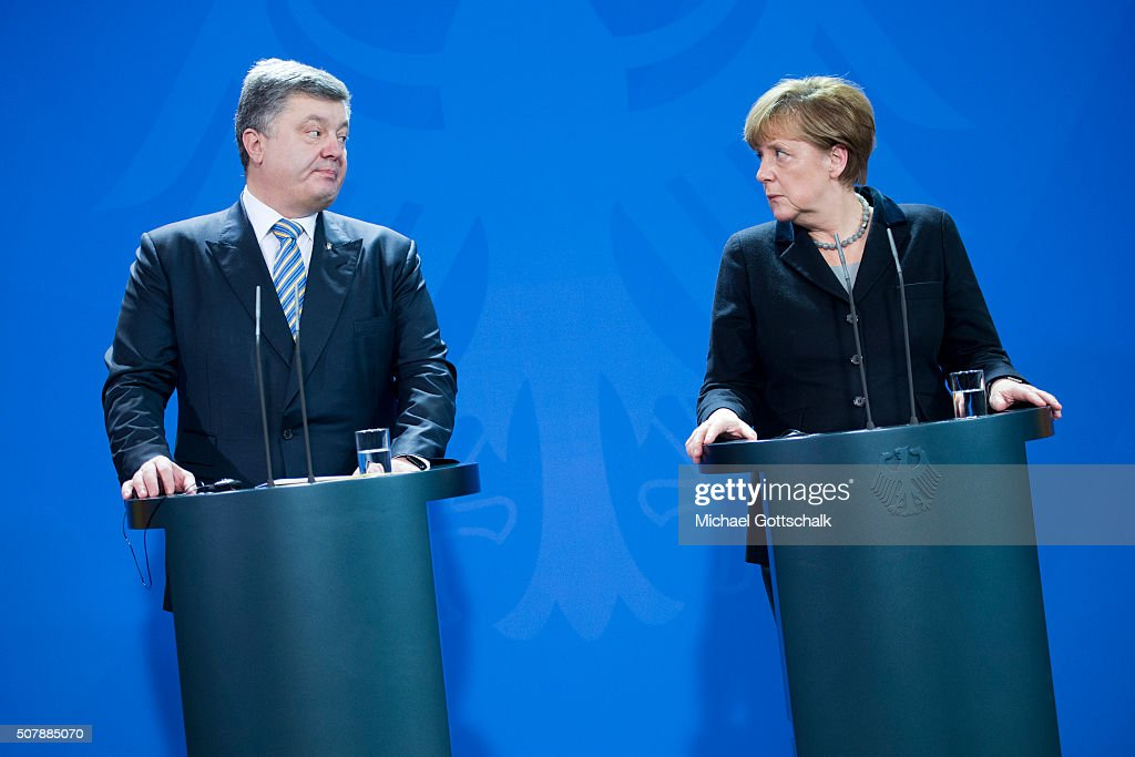 German Chancellor Angela Merkel and President of Ukraine Petro Poroschenko address the media prior to a meeting in the German Chancellery on February 01, 2016 in Berlin, Germany. The two leaders met primarily to discuss the situation in Ukraine, with both leaders urging the EU to renew sanctions againt Russia for its support of pro-Russian rebels in the east of Ukraine.