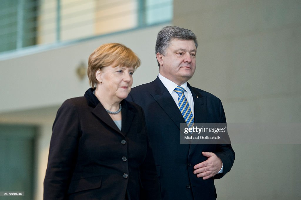 German Chancellor Angela Merkel and President of Ukraine Petro Poroschenko arrive prior to a meeting in the German Chancellery on February 01, 2016 in Berlin, Germany. The two leaders met primarily to discuss the situation in Ukraine, with both leaders urging the EU to renew sanctions againt Russia for its support of pro-Russian rebels in the east of Ukraine.
