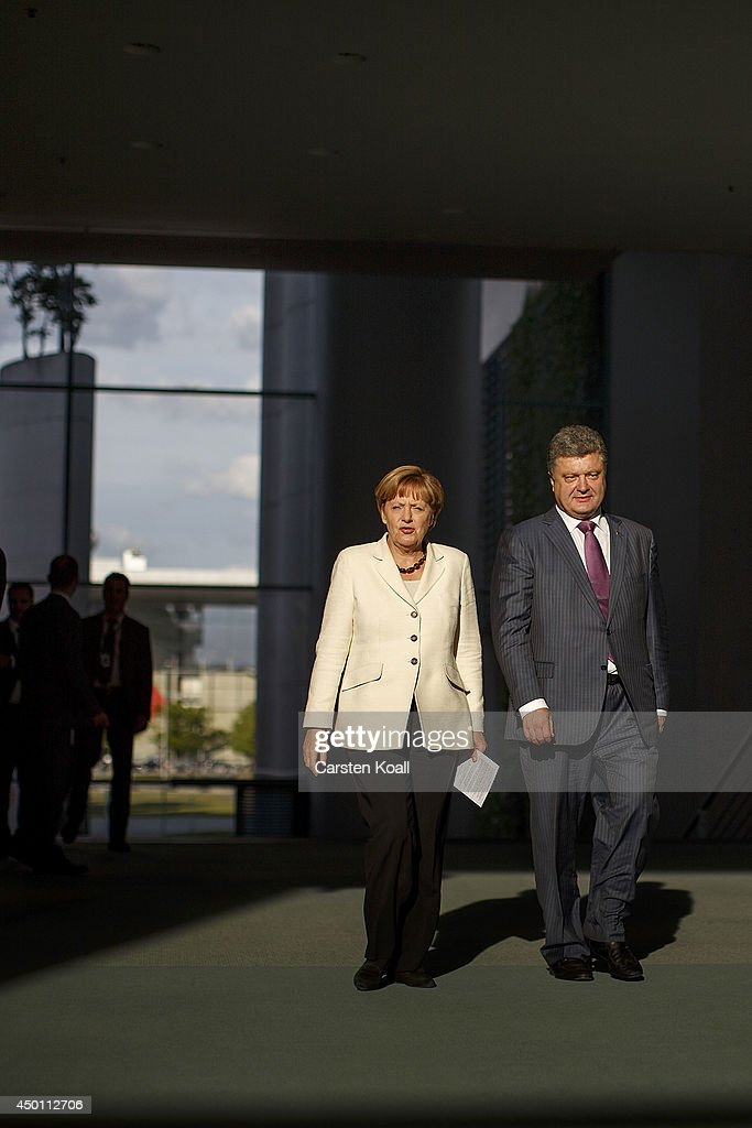 German Chancellor Angela Merkel (L) and recently-elected Ukrainian President Petro Poroshenko (R) arrive to give statements to the media prior to talks at the Chancellery on June 5, 2015 in Berlin, Germany. Poroshenko is meeting with western leaders as the situation in eastern Ukraine is descending further into war between government forces and Russian-backed separatists.