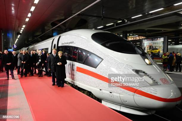 German Chancellor Angela Merkel and Richard Lutz chairman of German railway operator Deutsche Bahn pose next to an ICE high speed train after the...