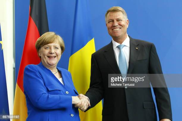 German Chancellor Angela Merkel and Romanian president Klaus Johannis speak during a press conference following their meeting in the german...
