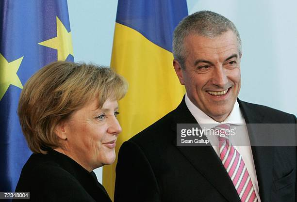 German Chancellor Angela Merkel and Romanian Prime Minister Calin Tariceanu smile at the conclusion of a news conference at the Chancellery November...