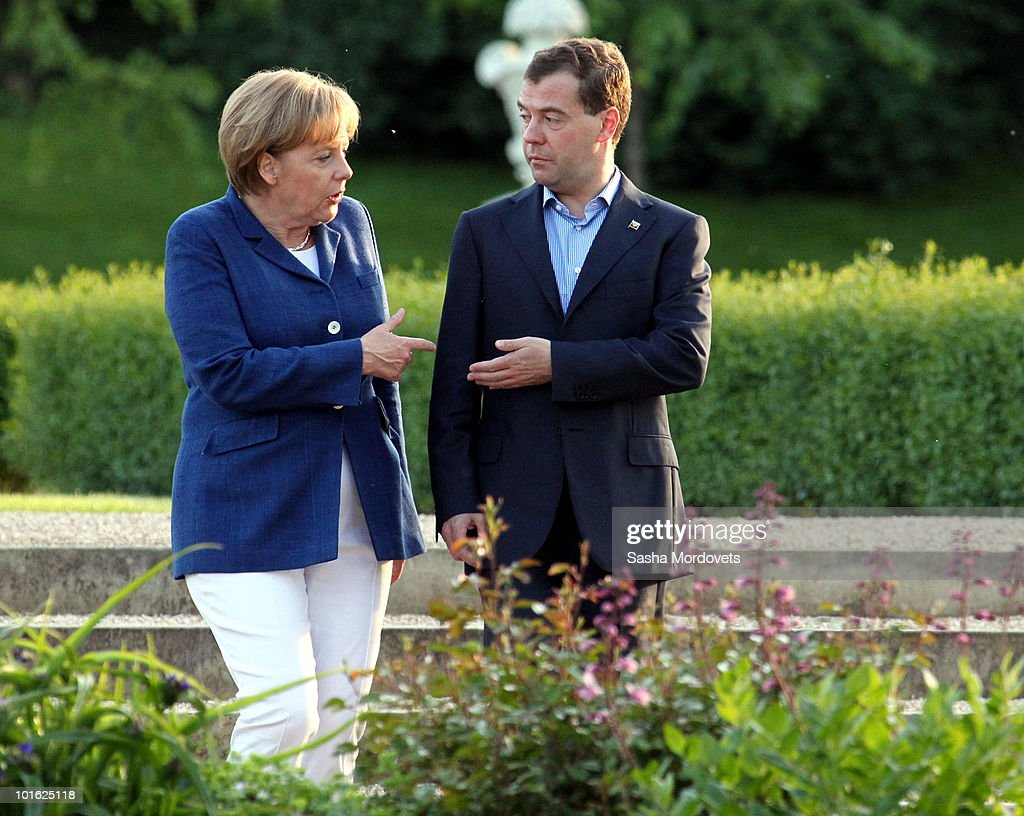 German Chancellor Angela Merkel and Russian President Dmitry Medvedev stroll in the gardens at Meseberg Palace on June 4, 2010 in Meseberg, Germany. Merkel and Medvedev are meeting at Meseberg today and tomorrow to discuss bilateral and international issues.