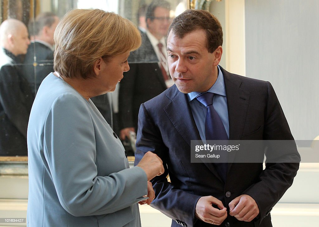 German Chancellor Angela Merkel and Russian President Dmitry Medvedev arrive for bilateral talks at Meseberg Palace on June 5, 2010 in Meseberg, Germany. Merkel and Medvedev have been meeting at Meseberg today and yesterday to discuss bilateral and international issues.