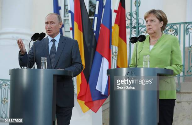 German Chancellor Angela Merkel and Russian President Vladimir Putin give statements to the media prior to talks at Schloss Meseberg palace the...