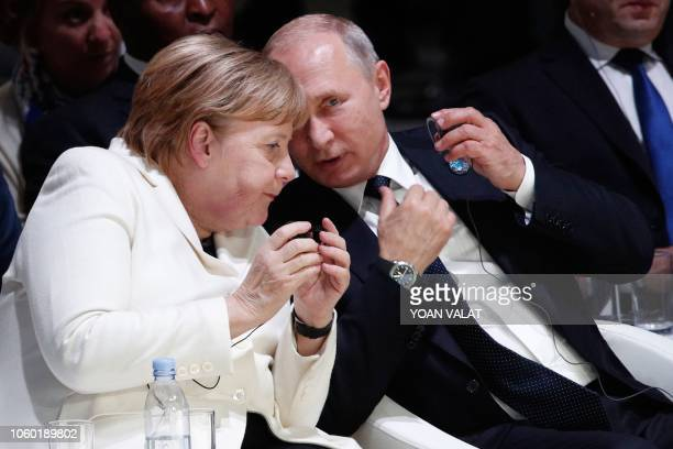 German Chancellor Angela Merkel and Russian President Vladimir Putin attend the opening ceremony of the Paris Peace Forum at the Villette Conference...