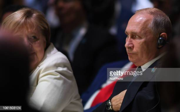 German Chancellor Angela Merkel and Russian President Vladimir Putin at the opening session of the Paris Peace Forum an event that is a part of the...