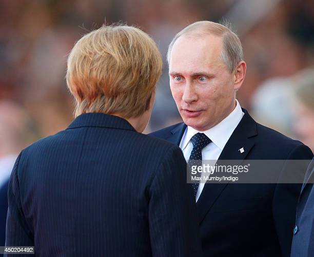 German Chancellor Angela Merkel and Russian President Vladimir Putin attend the International Ceremony at Sword Beach to commemorate the 70th...
