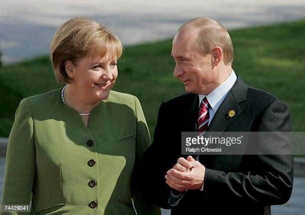 German Chancellor Angela Merkel and Russian President Vladimir Putin arrive for the first day of talks with other leaders of G8 industrialized...