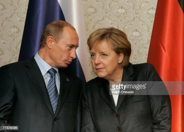 German Chancellor Angela Merkel and Russian President Vladimir Putin speak October 15 2007 in Wiesbaden Germany Representatives of German and Russian...