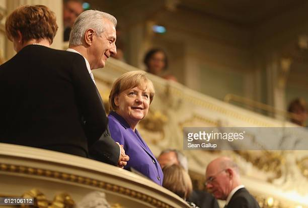 German Chancellor Angela Merkel and Saxony Governor Stanislaw Tillich arrive for celebrations to mark German Unity Day at the Semperoper opera house...