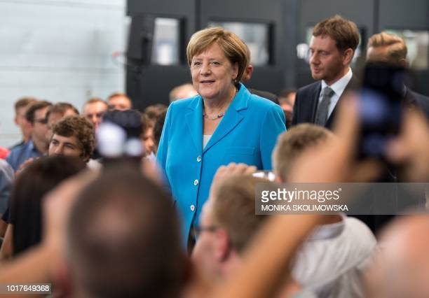 German Chancellor Angela Merkel and Saxony's Prime Minister Michael Kretschmer visit the Trumpf Sachsen GmbH engineering company in Neukirch near...