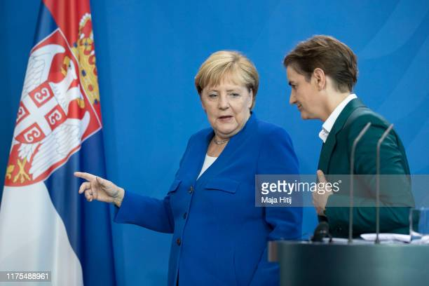 German Chancellor Angela Merkel and Serbian Prime Minister Ana Brnabic leave after a press conference after a meeting at the Chancellery in Berlin on...