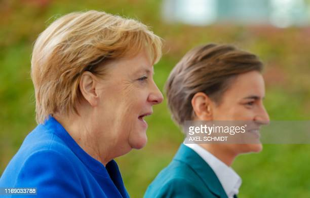 German Chancellor Angela Merkel and Serbian Prime Minister Ana Brnabic talk during a welcoming ceremony in front of the Chancellery in Berlin on...