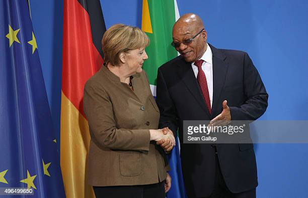 German Chancellor Angela Merkel and South African President Jacob Zuma depart after speaking to the media following talks at the Chancellery on...