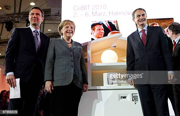 German Chancellor Angela Merkel and Spanish Prime Minister Jose Luis Rodriguez Zapatero pose after a presentation of a digitallysupervised energy...
