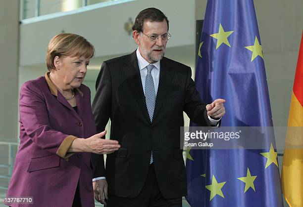German Chancellor Angela Merkel and Spanish Prime Minister Mariano Rajoy arrive to speak to the media following talks at the Chancellery on January...