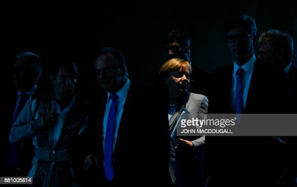 TOPSHOT German Chancellor Angela Merkel and Stuttgart's mayor Fritz Kuhn German Environment Minister Barbara Hendricks SaxonyAnhalt's State Premier...