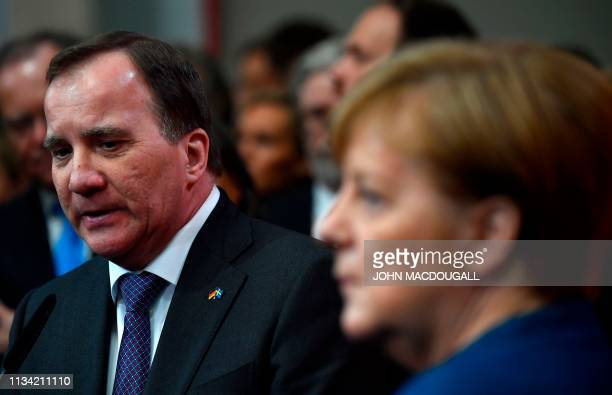 German Chancellor Angela Merkel and Swedish Prime Minister Stefan Lofven give statements at the end of their tour at the Hanover Messe technology...