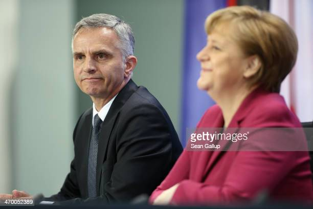German Chancellor Angela Merkel and Swiss President Didier Burkhalter speak to the media after talks at the Chancellery on February 18 2014 in Berlin...