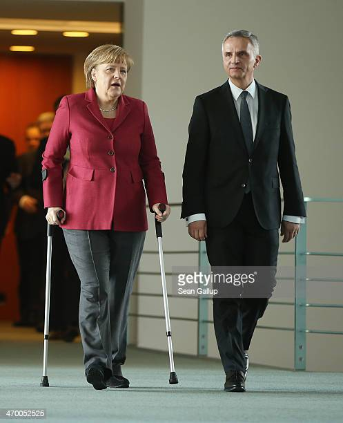German Chancellor Angela Merkel and Swiss President Didier Burkhalter arrive to speak to the media after talks at the Chancellery on February 18 2014...