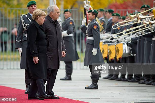 German Chancellor Angela Merkel and Swiss President Johann SchneiderAmmann review the guard of honour at the Chancellery in Berlin on November 2 2016