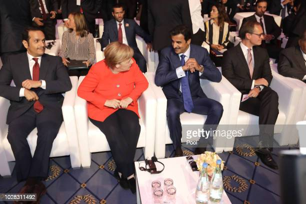 German Chancellor Angela Merkel and the Emir of Qatar Sheikh Tamim bin Hamad AlThani speak at the Qatar Germany Business and Investment Forum on...