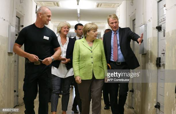 German Chancellor Angela Merkel and the Federal Government's Commissioner for Culture and the Media Monika Gruetters get expanations by German...