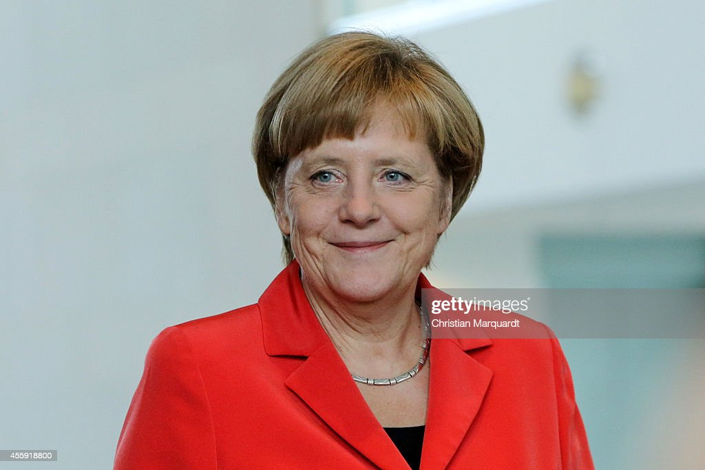German Chancellor Angela Merkel and the French Prime Minister Mauel Valls (unseen) talk to the media after their meeting in the Chancellery on September 22, 2014 in Berlin. The French Prime Minister is on a 2 day trip to Germany, during which he will attend meetings to discuss various political issues .