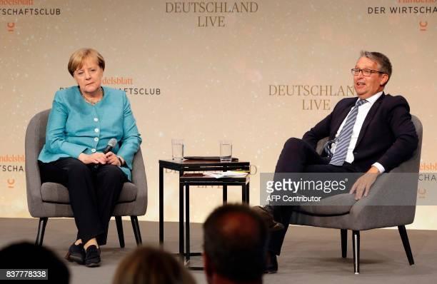 German Chancellor Angela Merkel and the Handelsblatt publisher Gabor Steingart attend the 'Deutschland Live' event organized by the economy news...