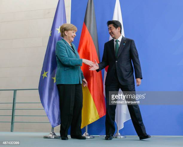German Chancellor Angela Merkel and the Japanese Prime Minister Shinzo Abe shake hands following talks at the Chancellery on April 30 2014 in Berlin...