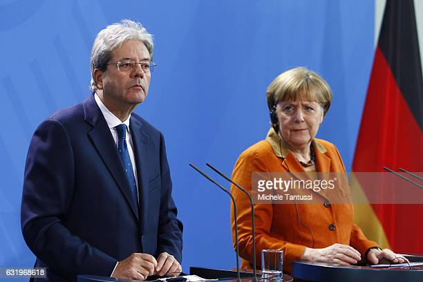 German Chancellor Angela Merkel and the new Italian Prime Minister Paolo Gentiloni speak during a joint press conference after their meeting at the...