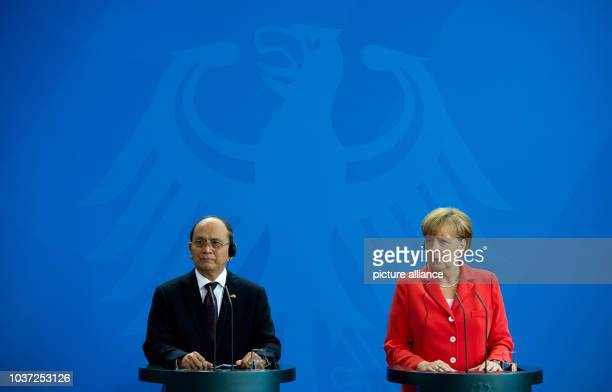 German Chancellor Angela Merkel and the President of Myanmar, Thein Sein, speak at a press conference in the Chancellery in Berlin, Germany, 03...