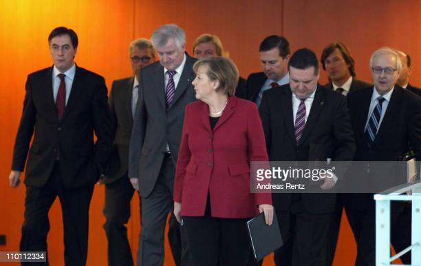 German Chancellor Angela Merkel and their state governors arrive for a statement following a hastilycalled for meeting of Merkel with the leaders of...