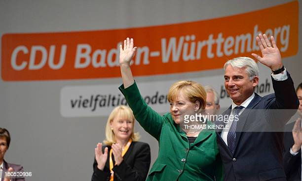German Chancellor Angela Merkel and Thomas Strobl regional party chairman of their CDU party in the southern German state of BadenWuerttemberg wave...