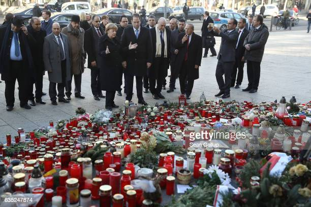 German Chancellor Angela Merkel and Tunisian Prime Minister Youssef Chahed arrive to lay flowers at a memorial to the December Berlin terror attack...