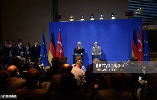 German Chancellor Angela Merkel and Turkish Prime Minister Binali Yildirim give a press conference on February 15, 2018 at the Chancellery in Berlin....