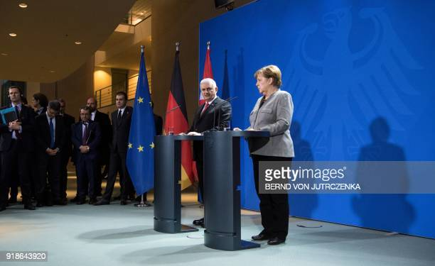 German Chancellor Angela Merkel and Turkish Prime Minister Binali Yildirim give a press conference on February 15 2018 at the Chancellery in Berlin...