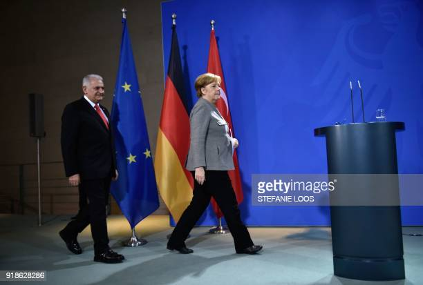 German Chancellor Angela Merkel and Turkish Prime Minister Binali Yildirim arrive to give a press conference on February 15, 2018 at the Chancellery...
