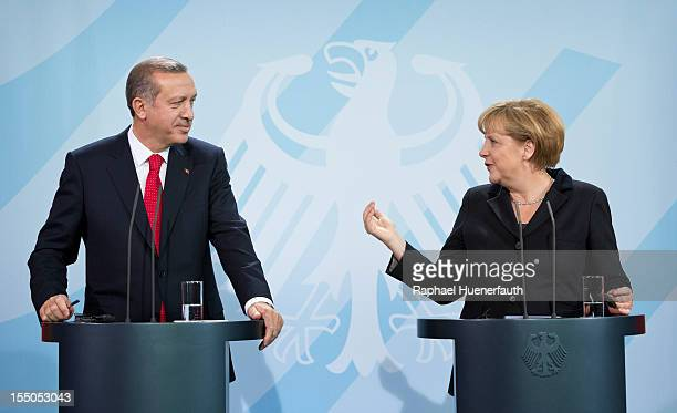 German Chancellor Angela Merkel and Turkish Prime Minister Recep Tayyip Erdogan hold a joint press conference on October 31 2012 in Berlin Germany...