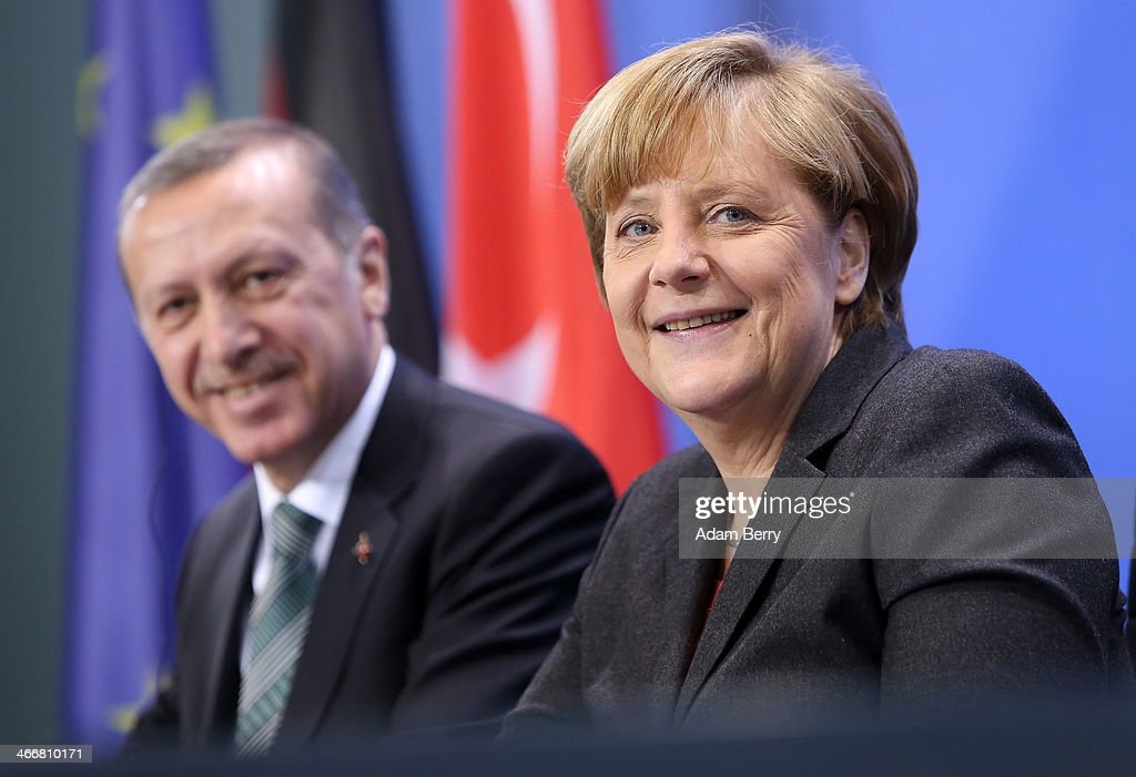 German Chancellor Angela Merkel (R) and Turkish Prime Minister Recep Tayyip Erdogan speak to the media following talks at the German federal Chancellery on February 4, 2013 in Berlin, Germany. The two leaders discussed issues including bilateral relations, the situation in Syria and the Turkish economy.