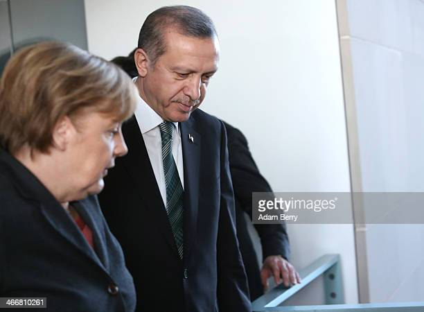 German Chancellor Angela Merkel and Turkish Prime Minister Recep Tayyip Erdogan leave the room after speaking to the media following talks at the...