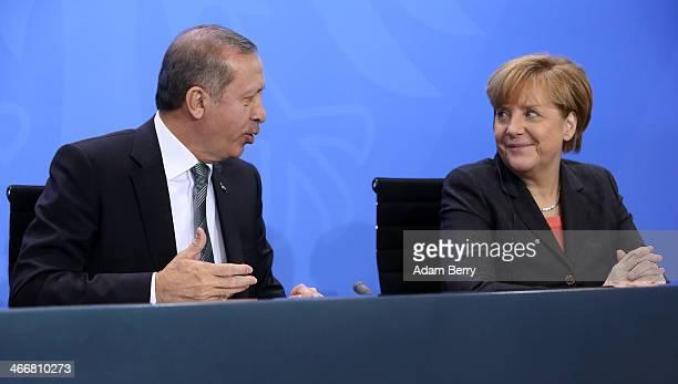 German Chancellor Angela Merkel and Turkish Prime Minister Recep Tayyip Erdogan speak to the media following talks at the German federal Chancellery...